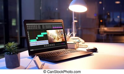 video editor program on laptop at night office - post ...