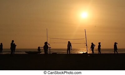 Volleyball at the beach in the sunset