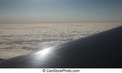 Airplane over clouds
