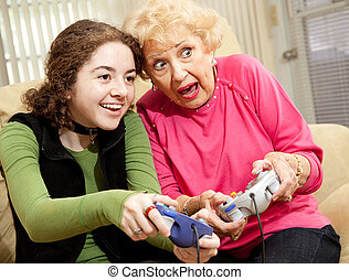 Video Game Excitement - Grandmother and granddaughter ...