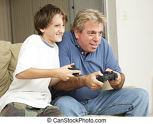 Video Game Fun - Father or uncle playing video games with a...