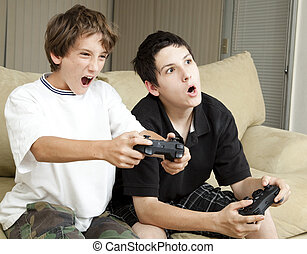 Video Games - Winning - Competitive brothers playing video...