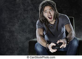Video Gaming - Young man enjoys playing games