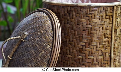 Video hand close rattan basket. Asian craft object