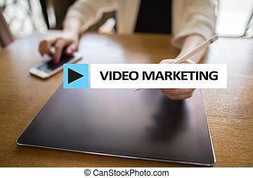 Video marketing, advertising concept on virtual screen.