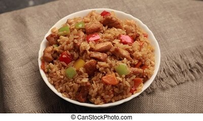 Chahan fried rice with chicken rotates on table