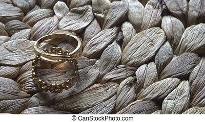 video movie Wedding rings accessory lying on straw table....