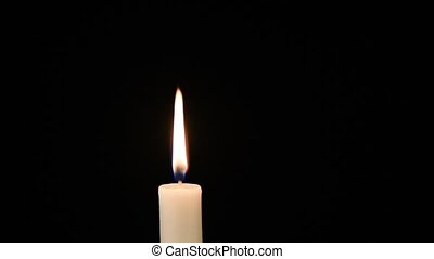 Video of a burning candle against a black background. Duration 10 seconds.