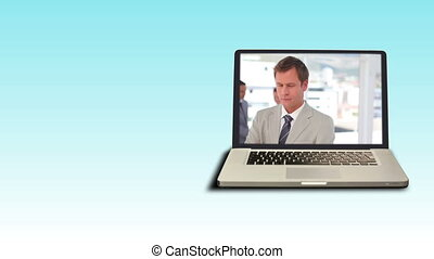 Video of a businessman on a laptop