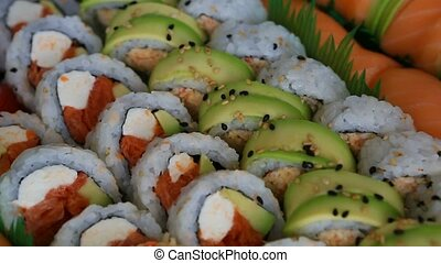 Video of a platter of sushi rolls with both raw and cooked...