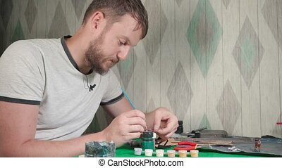 Video of craftsman making tin soldier at home