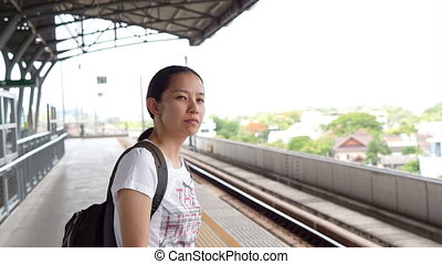 Asian tourist at train station - Video of Asian tourist at...