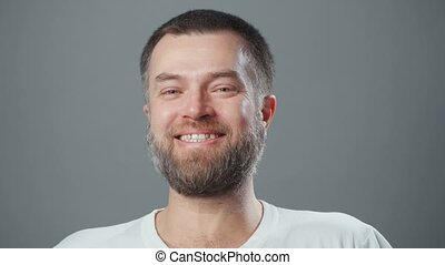 Video of bearded laughing man