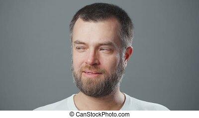 Video of bearded thinking man