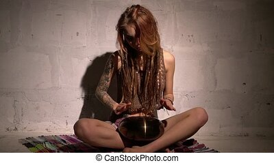 Video of blonde with dreadlocks playing tapidrum - Tattooed ...