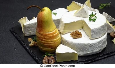 Video of camembert cheese and pear on stone serving board