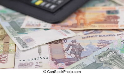 Video of diary and pen lie on the ruble. Dolly shot. Close-up. Shallow depth of field