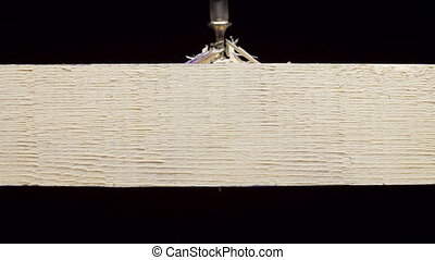 Video of drilling an tapping screw out of wooden board -...