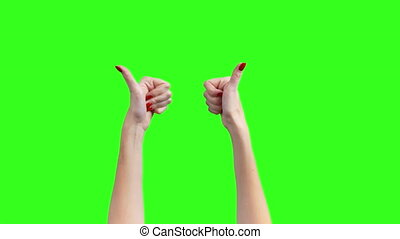Video of female hands on green background