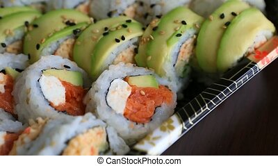 Video of fresh sushi rolls prepared with both raw and cooked...