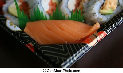 Video of fresh sushi rolls prepared with both raw and cooked ingredients 1080p