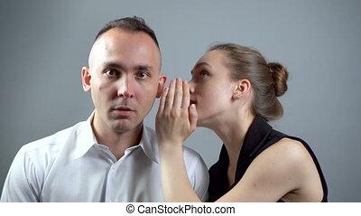 Video of girl talking secret on grey background - Video of...
