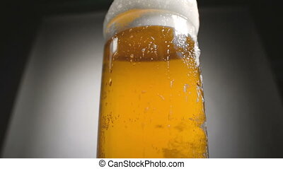 Video of gold beer in glass with white froth