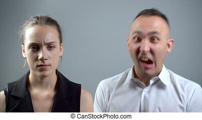 Video of grimacing man and woman - Video of man and woman...