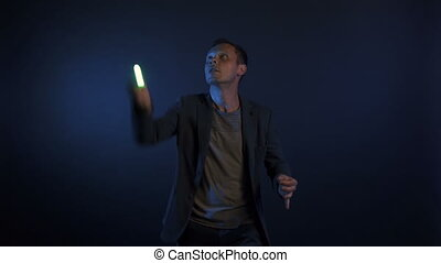 Video of illusionist man with lights