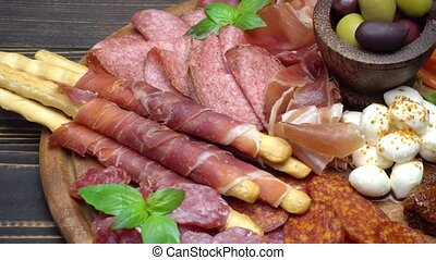 Video of italian meat plate - sliced prosciutto, sausage and...