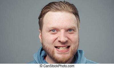 Video of mad blond man in blue sweatshirt, portrait - Video ...