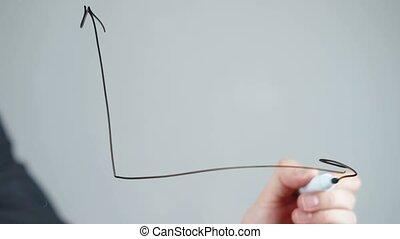 Video of man drawing on glass board on grey background