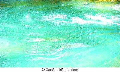 Video of mountain river with blue or turquoise water. Slow Motion