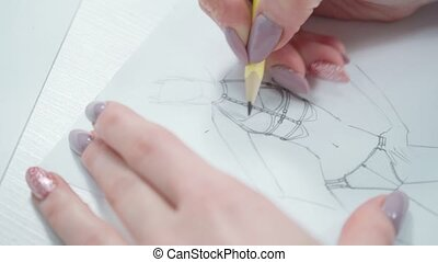 Video of modeler woman drawing sketch by pencil