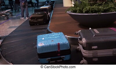Luggages on a conveyor belt
