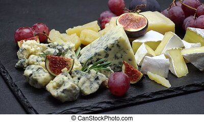 Video of roquefort or dorblu, brie, and parmesan cheese and...