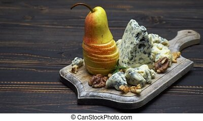 Video of roquefort or dorblu cheese and pears on wooden...