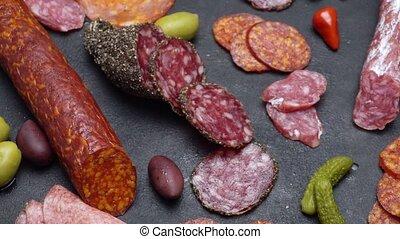 salami and chorizo sausage close up on dark concrete...