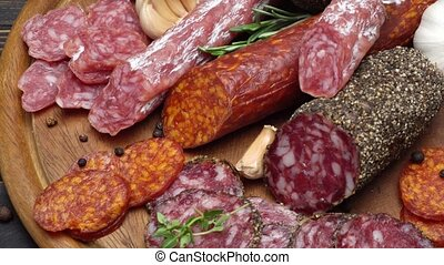 salami and chorizo sausage close up on wooden background -...