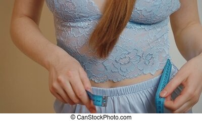 Video of seamstress takes measurements of the young girl - ...