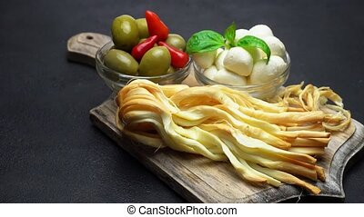 Video of Smoked braided cheese, mozzarella and olives on...