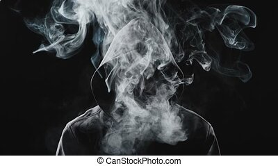 Video of smoker man in the hood on black background