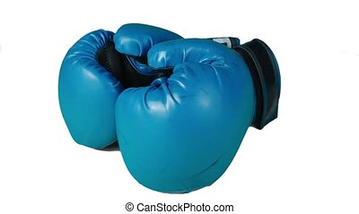 Video of spinning round boxing gloves on isolated background