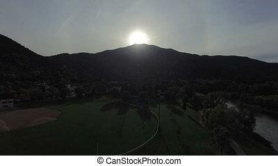 Video of sun rising above mountain