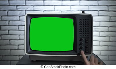 Video of turning on the retro tv with chroma key