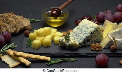Video of various types of cheese - parmesan, brie, cheddar...