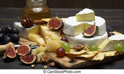 Video of various types of cheese - parmesan, brie, cheddar -...