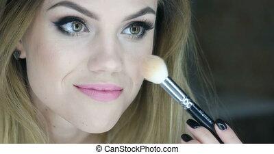 Video of woman applying powder