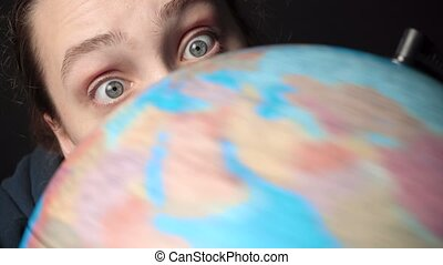 Video of woman looking at spinning globe