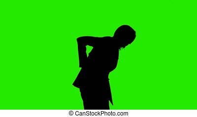 Video of woman's silhouette in suit jacket with backache on green background